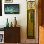Case Study house vignette Herman Miller clock, vintage art pottery.
